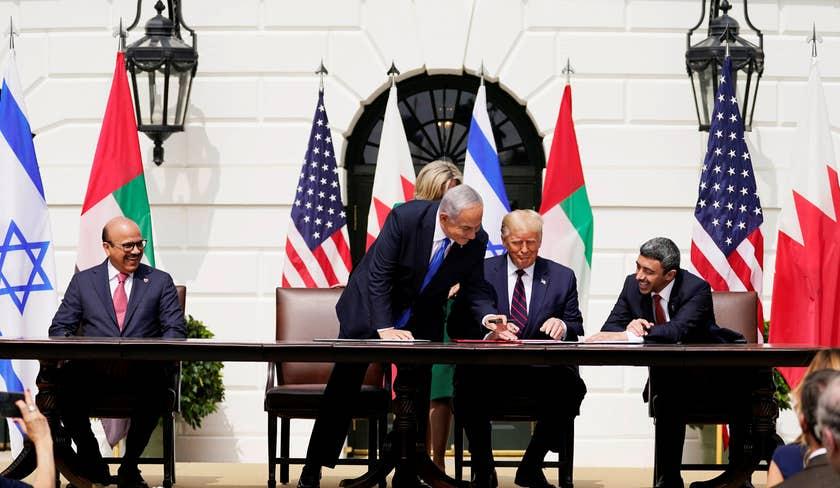 From left, Bahrain FM, Israeli PM, U.S. President, and UAE FM sign the Abraham Accords, Washington, DC, September 15, 2020.